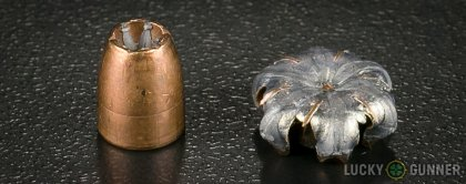 Side by side comparison of an unfired Winchester .380 Auto (ACP) bullet vs. the unfired round
