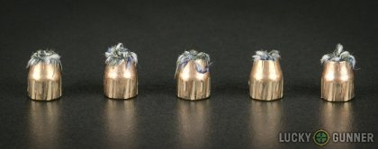 Side by side comparison of an unfired Federal .380 Auto (ACP) bullet vs. the unfired round