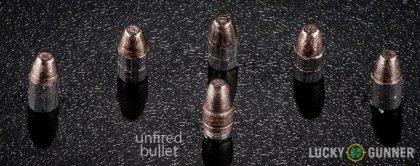 View from up above of fired Aguila .22 Long Rifle (LR) bullets compared to an unfired round