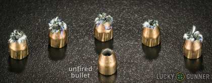 View from up above of fired Federal .380 Auto (ACP) bullets compared to an unfired round