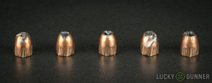 Side by side comparison of an unfired Remington .380 Auto (ACP) bullet vs. the unfired round