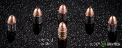 Image displaying fired .22 Long Rifle (LR) rounds compared to an unfired bullet
