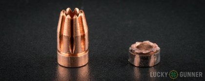Image displaying fired 10mm Auto rounds compared to an unfired bullet