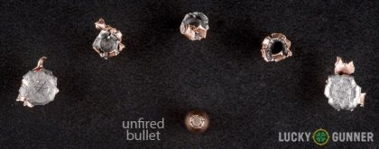 View from up above of fired Hornady .22 Magnum (WMR) bullets compared to an unfired round