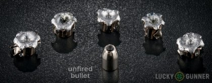 Side by side comparison of an unfired Winchester 10mm Auto bullet vs. the unfired round