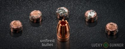 View from up above of fired G2 Research 10mm Auto bullets compared to an unfired round