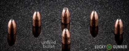 Side by side comparison of an unfired Fiocchi .22 Magnum (WMR) bullet vs. the unfired round