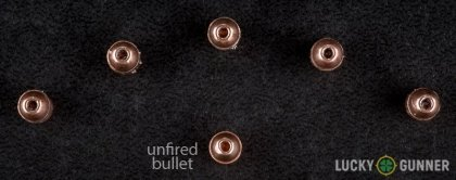 View from up above of fired CCI .22 Magnum (WMR) bullets compared to an unfired round