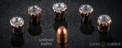 View from up above of fired Hornady 10mm Auto bullets compared to an unfired round