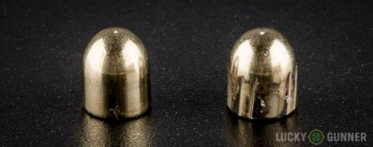 View from up above of fired Sellier & Bellot 9mm Makarov (9x18mm) bullets compared to an unfired round