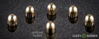 Side by side comparison of an unfired Sellier & Bellot 9mm Makarov (9x18mm) bullet vs. the unfired round