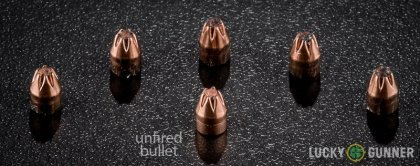 View from up above of fired Hornady .25 Auto (ACP) bullets compared to an unfired round