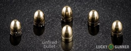 View from up above of fired Fiocchi .32 Auto (ACP) bullets compared to an unfired round