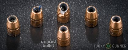 Side by side comparison of an unfired Federal .38 Special bullet vs. the unfired round