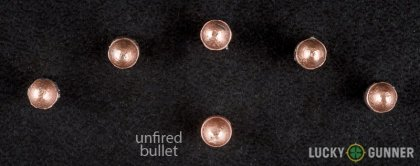 View from up above of fired CCI .22 Long Rifle (LR) bullets compared to an unfired round