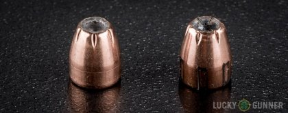 View from up above of fired Hornady .32 Auto (ACP) bullets compared to an unfired round
