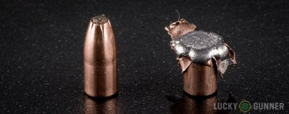 Side by side comparison of an unfired Hornady .22 Magnum (WMR) bullet vs. the unfired round
