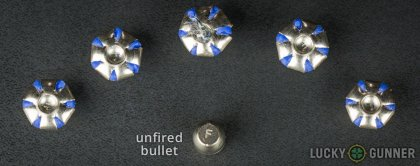 Side by side comparison of an unfired Federal .40 S&W (Smith & Wesson) bullet vs. the unfired round