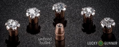 View from up above of fired Speer .327 Federal Magnum bullets compared to an unfired round