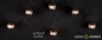Side by side comparison of an unfired Winchester .22 Magnum (WMR) bullet vs. the unfired round