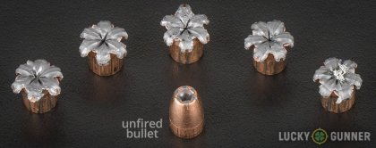 Side by side comparison of an unfired Speer 9mm Luger (9x19) bullet vs. the unfired round