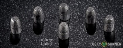 Side by side comparison of an unfired Federal .32 H&R Magnum bullet vs. the unfired round