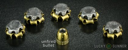 Side by side comparison of an unfired Remington .45 ACP (Auto) bullet vs. the unfired round