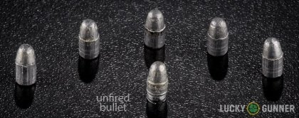 View from up above of fired Federal .22 Long Rifle (LR) bullets compared to an unfired round