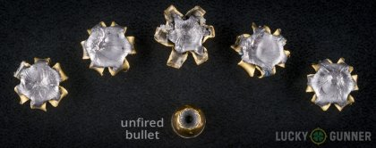 View from up above of fired Remington .357 Magnum bullets compared to an unfired round