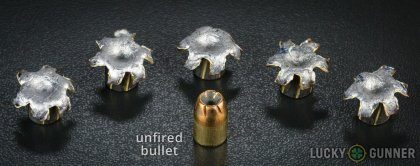 View from up above of fired Remington .40 S&W (Smith & Wesson) bullets compared to an unfired round