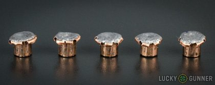 View from up above of fired Corbon 9mm Luger (9x19) bullets compared to an unfired round