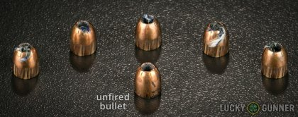 View from up above of fired Remington .380 Auto (ACP) bullets compared to an unfired round