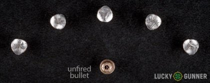 View from up above of fired Winchester .22 Long Rifle (LR) bullets compared to an unfired round