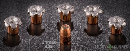 View from up above of fired Speer 10mm Auto bullets compared to an unfired round