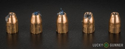 Side by side comparison of an unfired Magtech 9mm Luger (9x19) bullet vs. the unfired round