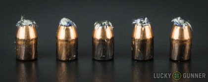 Side by side comparison of an unfired PMC .40 S&W (Smith & Wesson) bullet vs. the unfired round