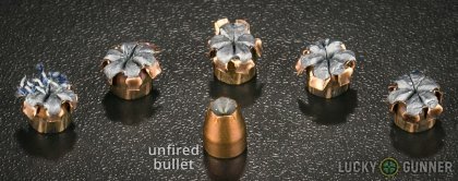 Side by side comparison of an unfired SIG SAUER .380 Auto (ACP) bullet vs. the unfired round
