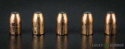 View from up above of fired Prvi Partizan 9mm Luger (9x19) bullets compared to an unfired round