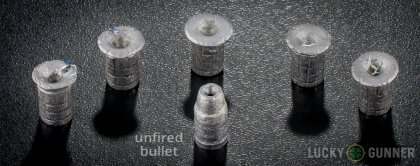 Side by side comparison of an unfired Winchester .38 Special bullet vs. the unfired round