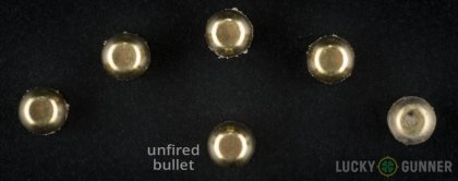 View from up above of fired Buffalo Bore 10mm Auto bullets compared to an unfired round