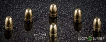 View from up above of fired Fiocchi .25 Auto (ACP) bullets compared to an unfired round