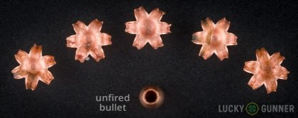 View from up above of fired Barnes .357 Magnum bullets compared to an unfired round