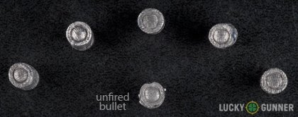 View from up above of fired Magtech .32 (Smith & Wesson) Long bullets compared to an unfired round