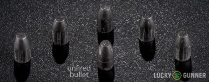 Image displaying fired .32 (Smith & Wesson) Long rounds compared to an unfired bullet