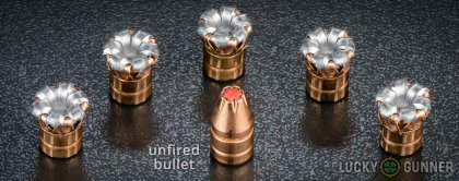View from up above of fired Hornady 9mm Luger (9x19) bullets compared to an unfired round