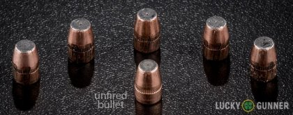 View from up above of fired Federal .327 Federal Magnum bullets compared to an unfired round