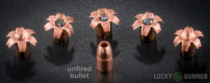 Side by side comparison of an unfired Buffalo Bore .357 Magnum bullet vs. the unfired round