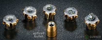 View from up above of fired Federal .40 S&W (Smith & Wesson) bullets compared to an unfired round