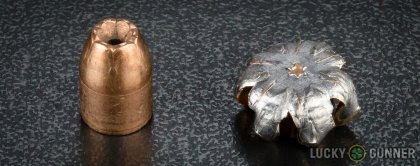 Side by side comparison of an unfired Winchester .40 S&W (Smith & Wesson) bullet vs. the unfired round