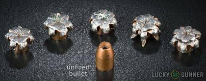 View from up above of fired Winchester .40 S&W (Smith & Wesson) bullets compared to an unfired round